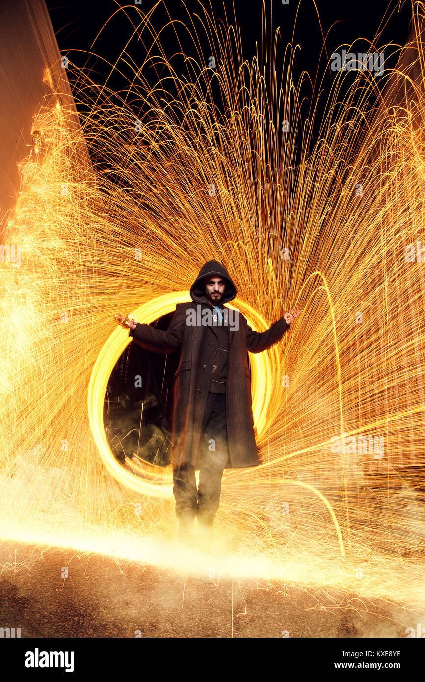 Wizard Floating in Front of Fire Ring - Stock Image