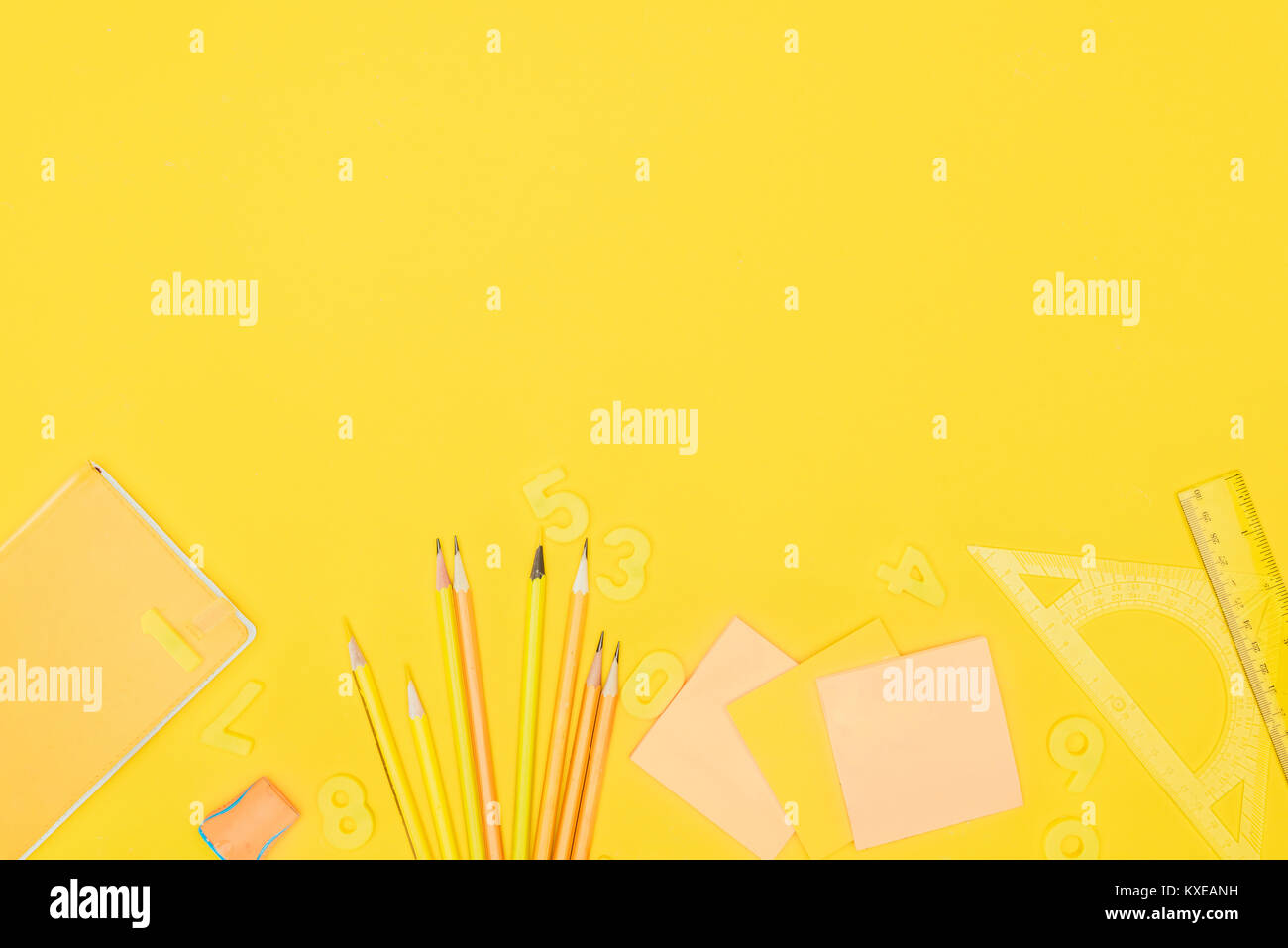 Top view of composition of colorful school supplies isolated on yellow background - Stock Image