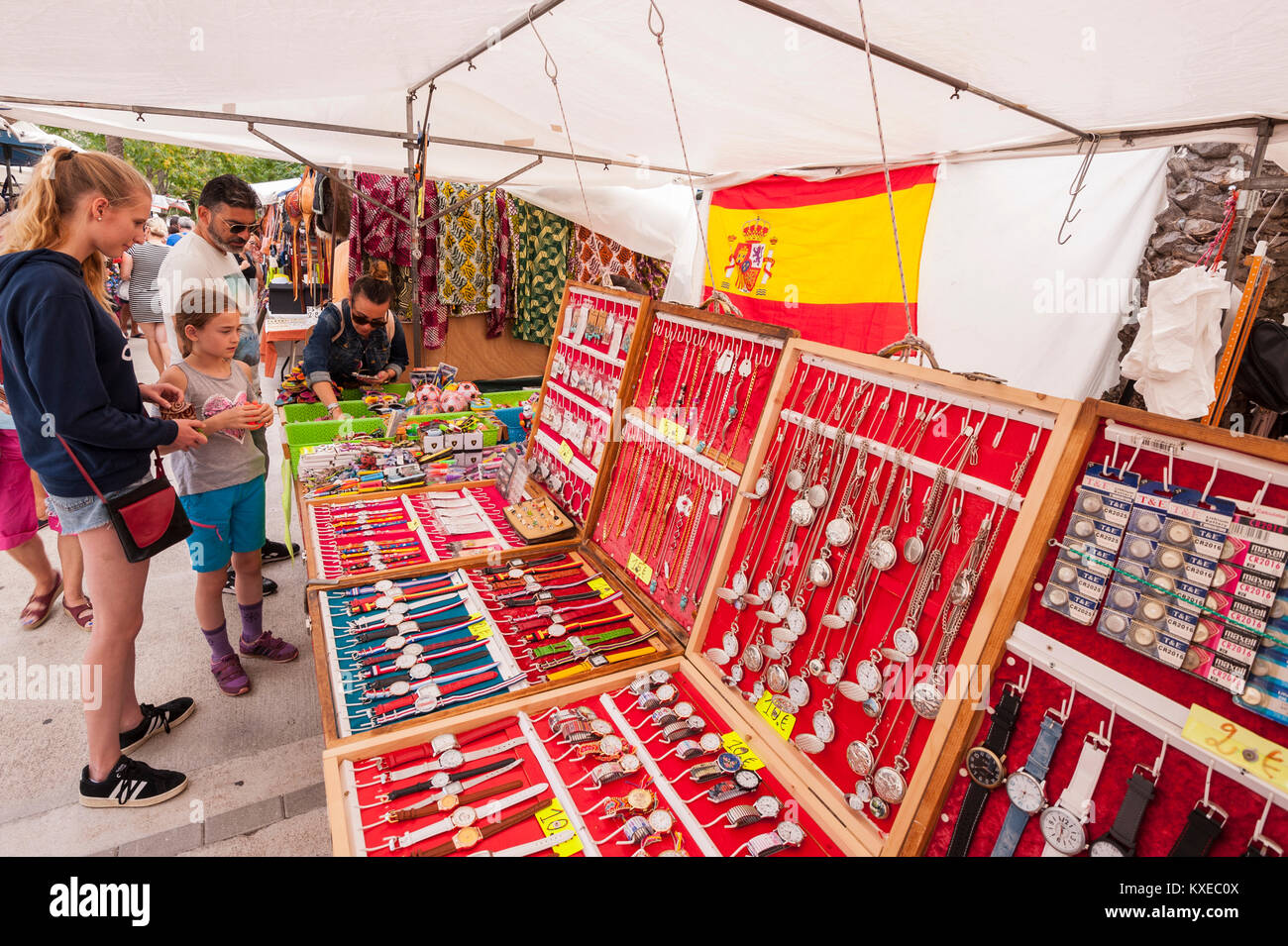 Watches and jewellery for sale at the street market in Mahon , Menorca , Balearic Islands , Spain - Stock Image