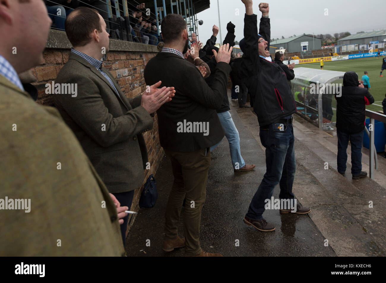 Home supporters celebrating Jim Lister's opening just before half-time at Station Park, Forfar during the SPFL League Stock Photo