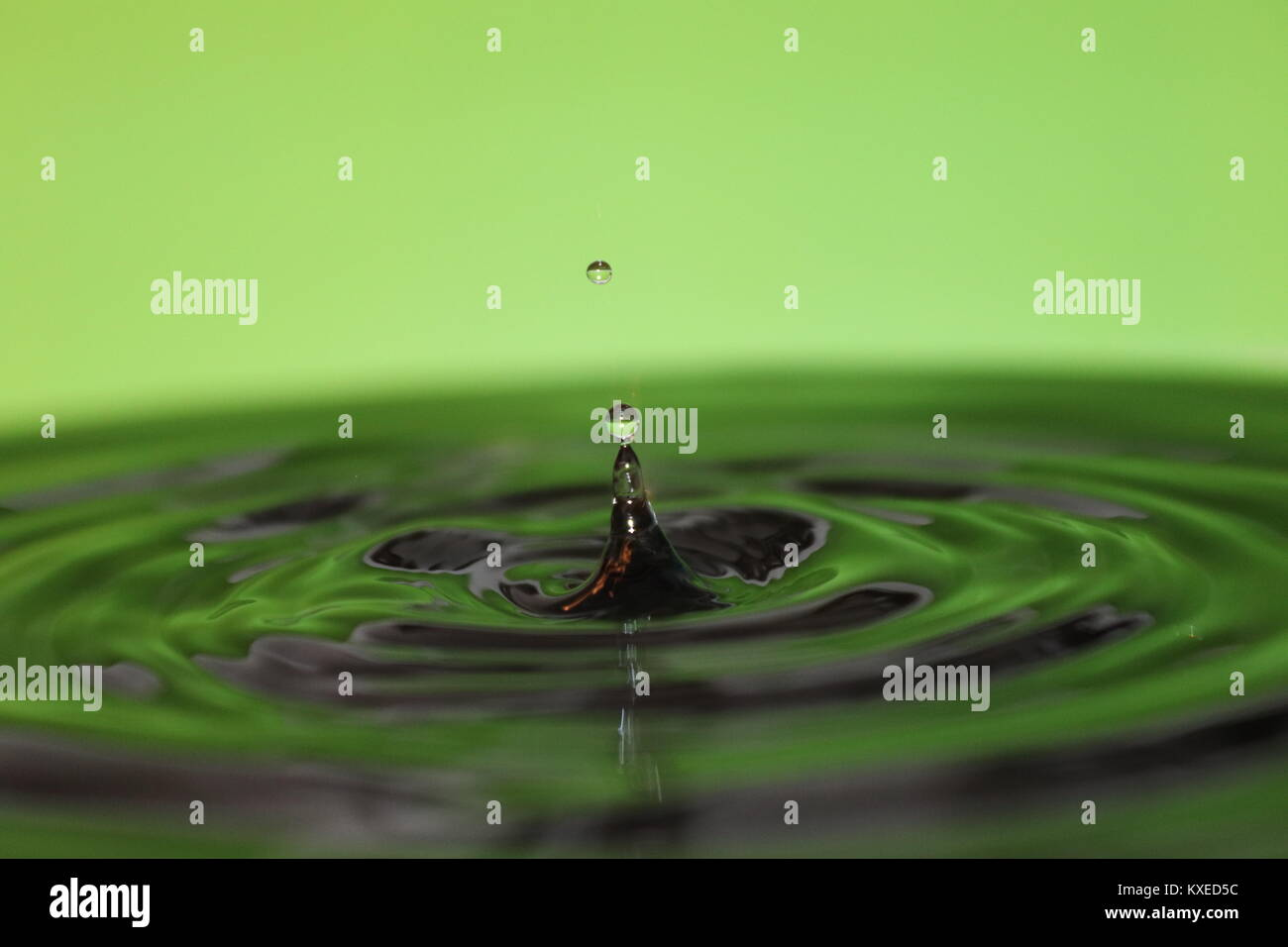 Water droplets photography drip drop shimmer pools of water reflecting light creating macro stunning images Stock Photo