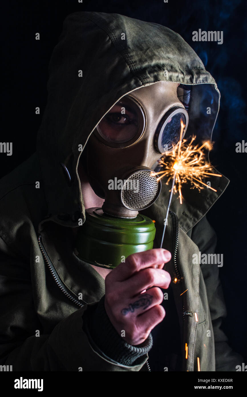 Studio shot depicting an post-apocalyptic scavenger in some underground location. - Stock Image