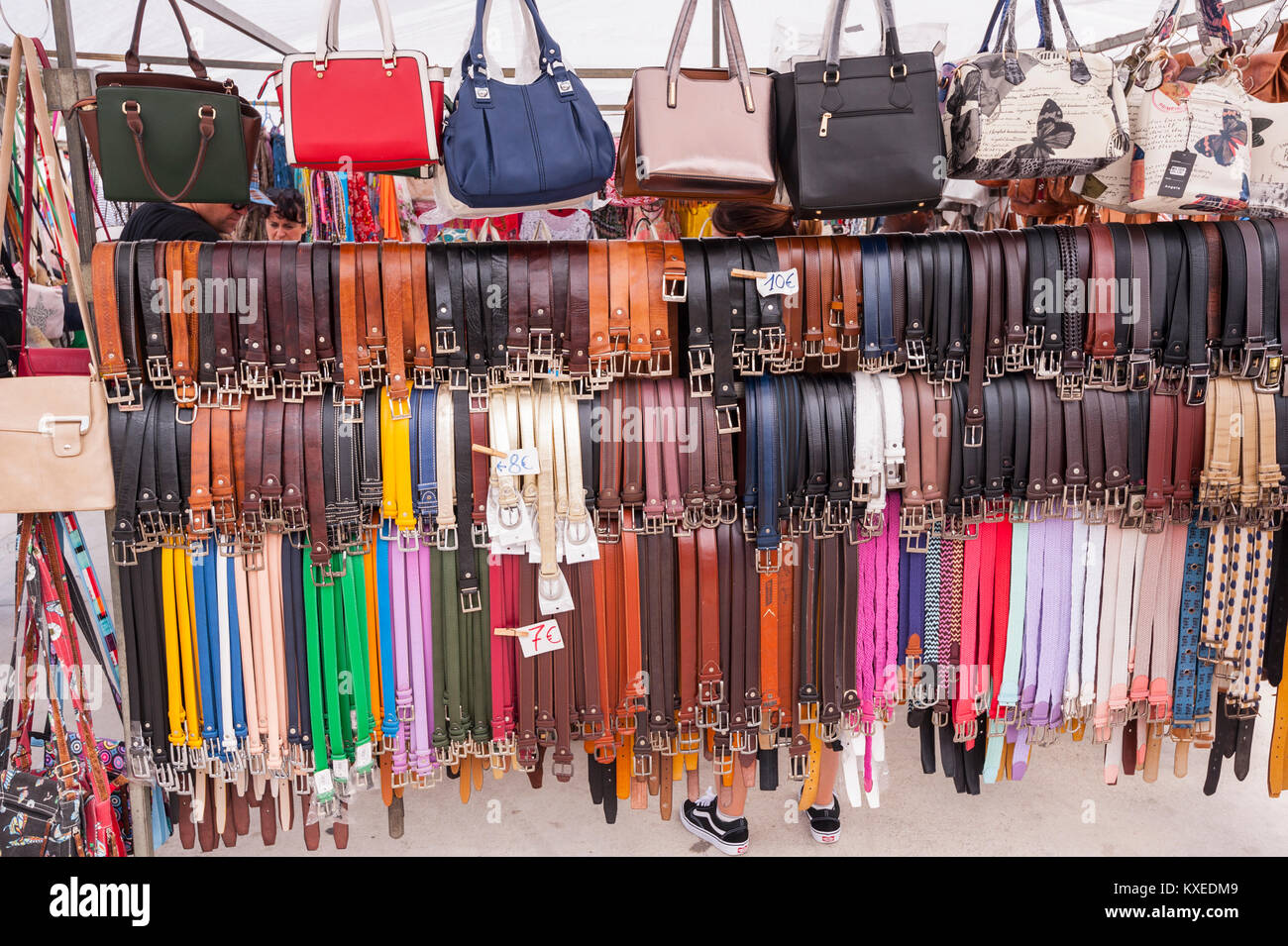 Belts for sale at the street market in Mahon , Menorca , Balearic Islands , Spain - Stock Image