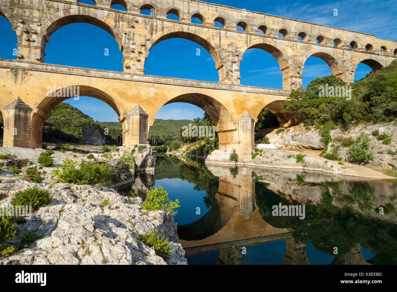 Roman bridge and aqueduct - Pont du Gard near Nimes, Occitanie (Languedoc-Roussillon), France - Stock Image