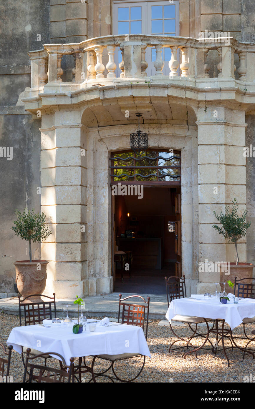 Tables set for dinner at Chateau Roussan near Saint Remy de-Provence France - Stock Image