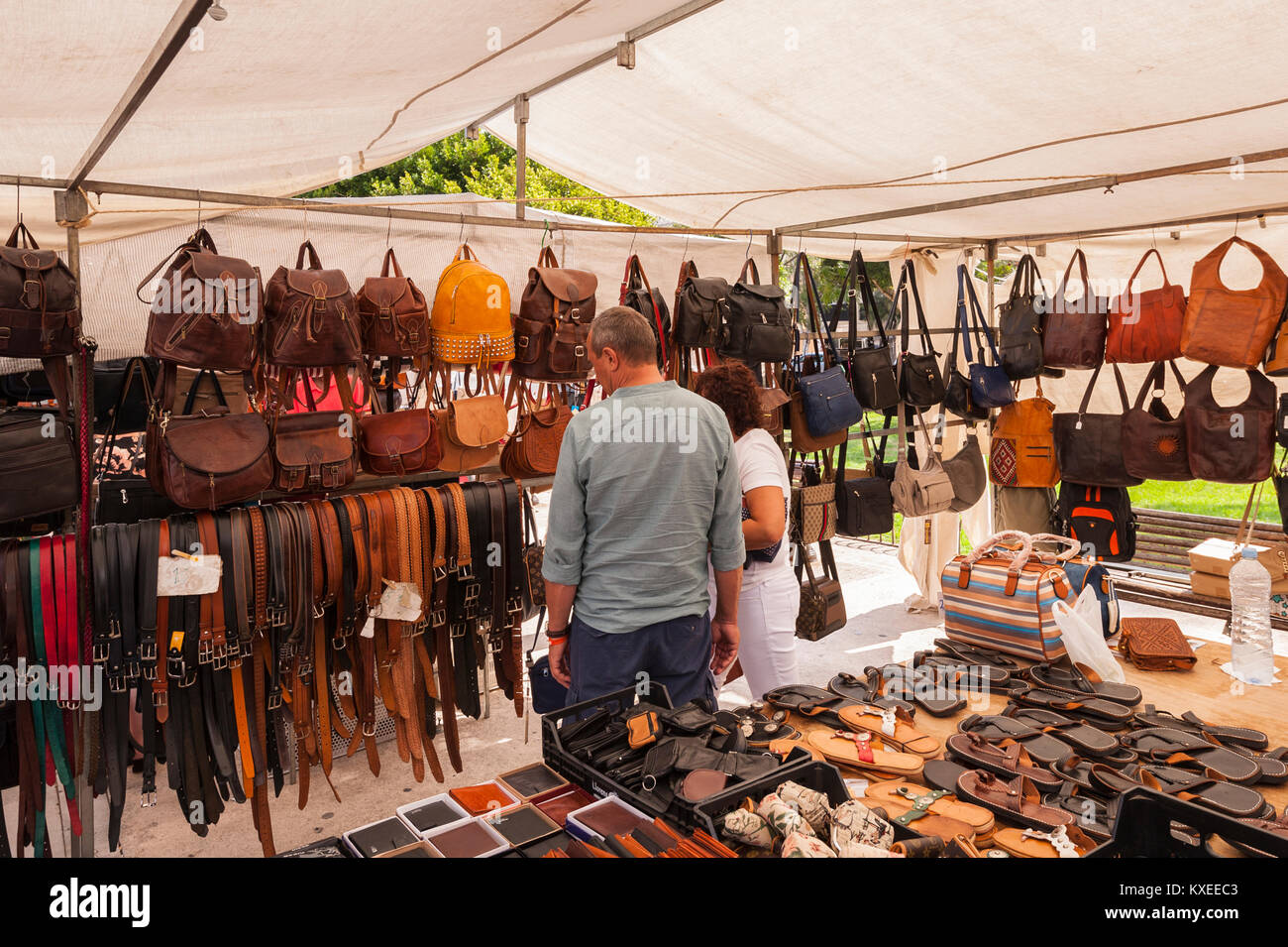Belts and bags for sale at the street market in Mahon , Menorca , Balearic Islands , Spain - Stock Image