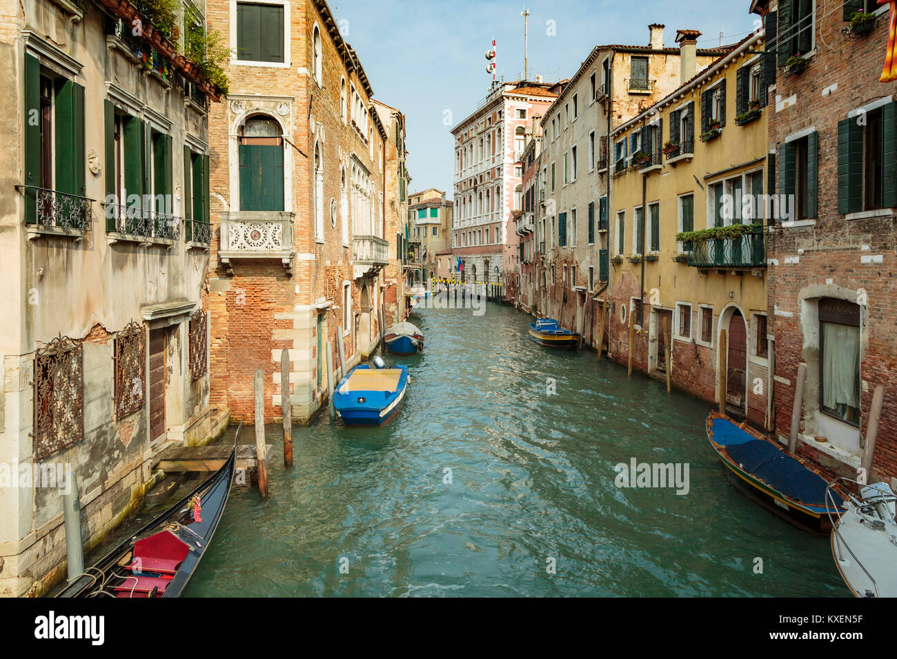 A canal view with boats in Veneto, Venice, Italy, Europe. - Stock Image