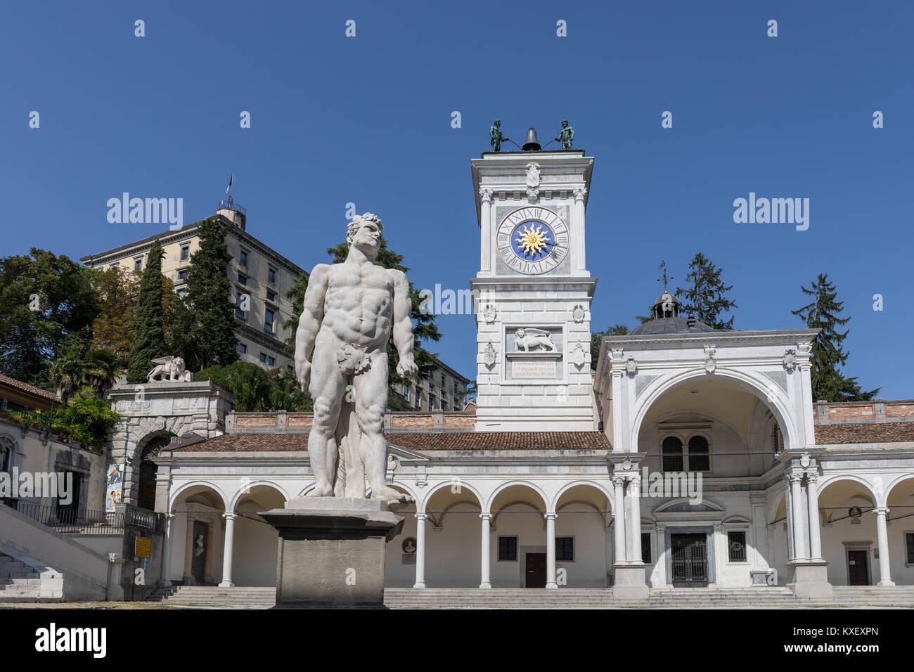 Piazza della Libertà square with clock tower, statue of Cacus and Loggia di San Giovanni - Udine, Friuli Venezia - Stock Image