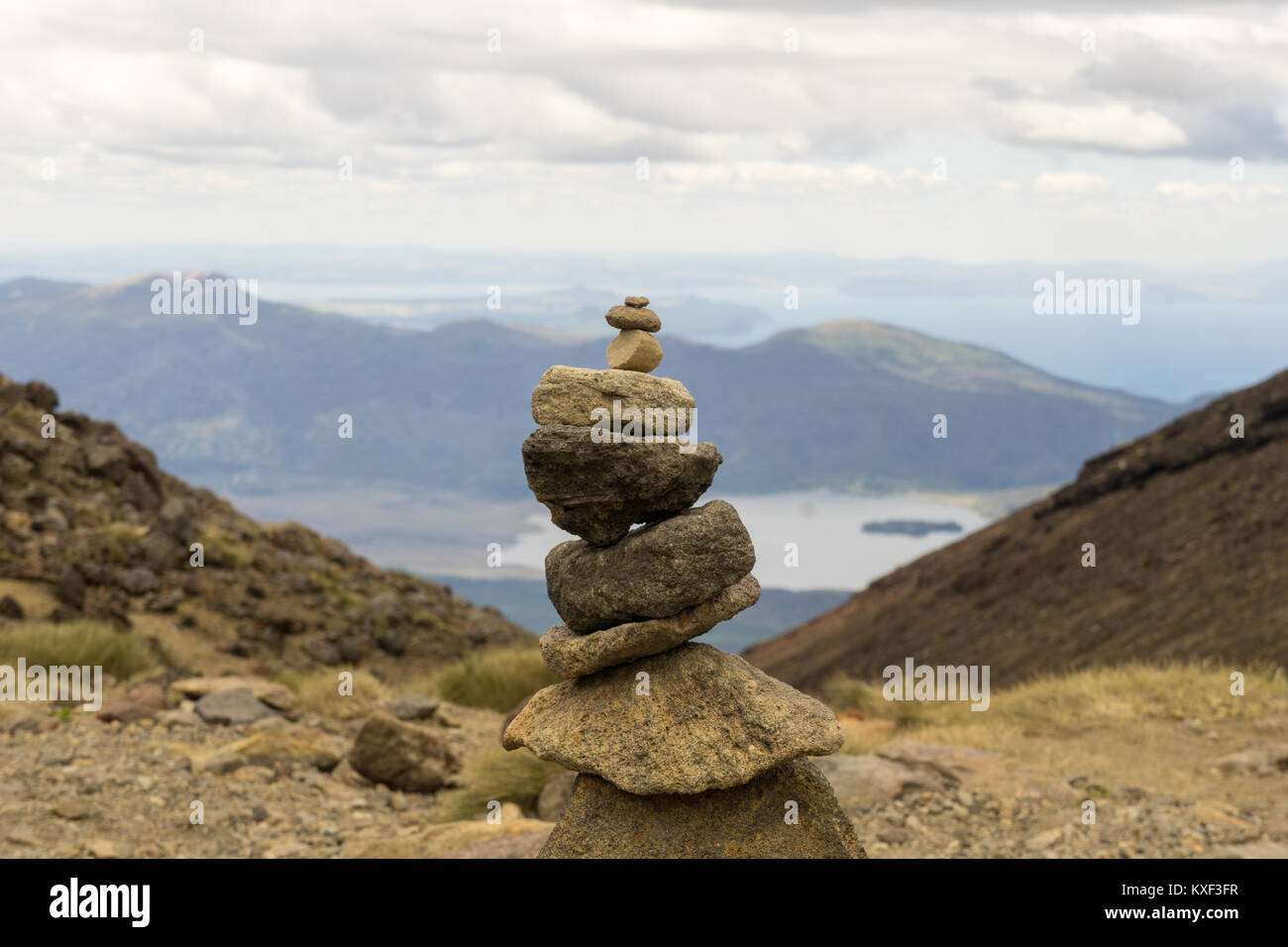 Stone tower with Lake Taupo in the background - Stock Image