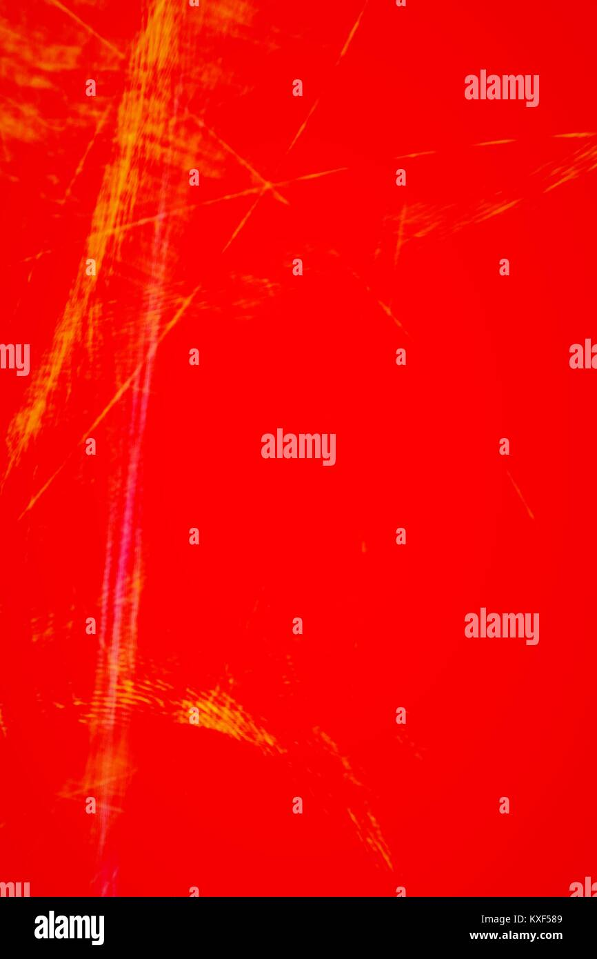 Abstract long exposure red and yellow light trails camera toss. - Stock Image