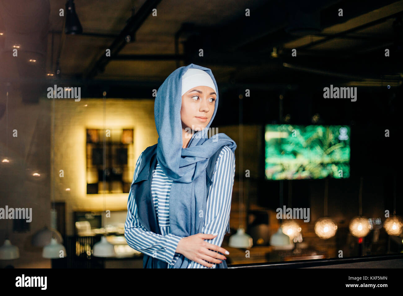 Portrait of a beautiful Muslim woman in cafe Stock Photo