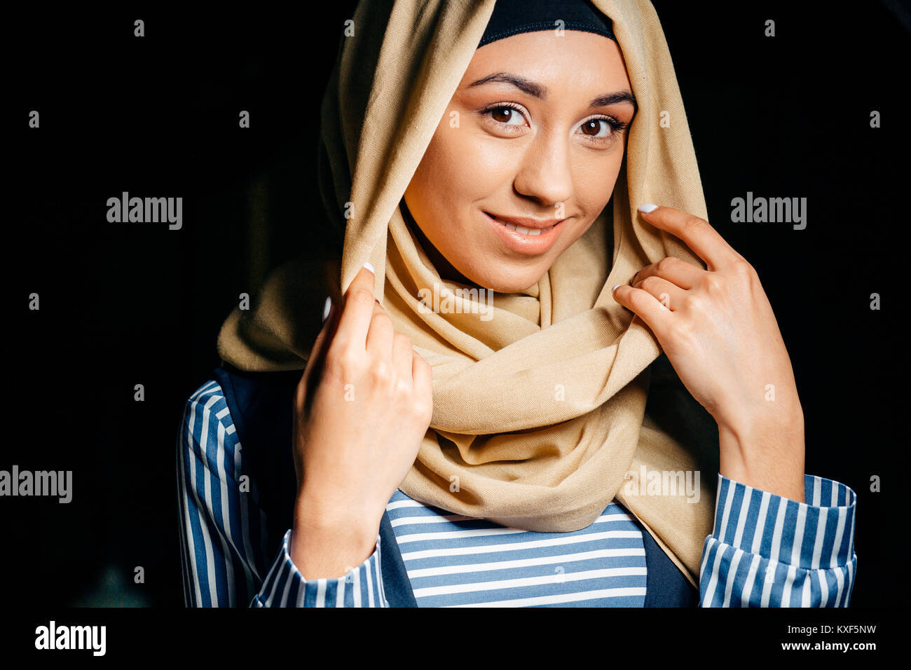 pretty muslim girl in hijab in cafe Stock Photo