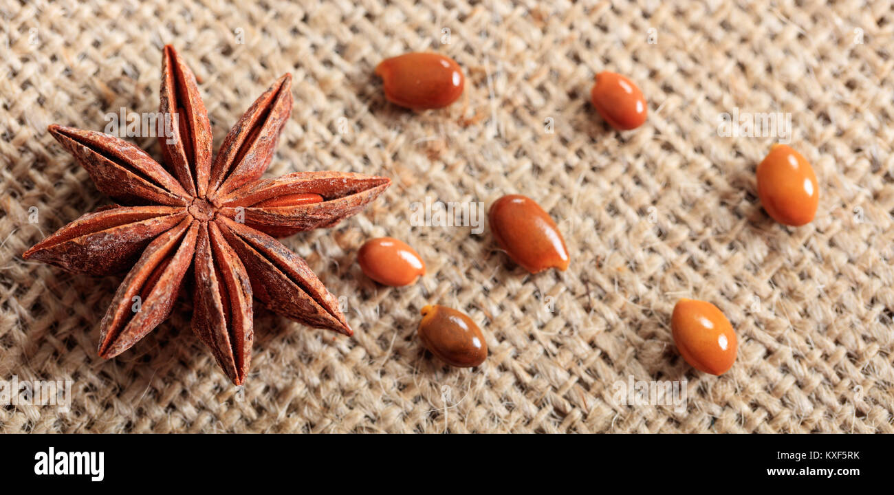 Dried star anise on a sackcloth - Stock Image