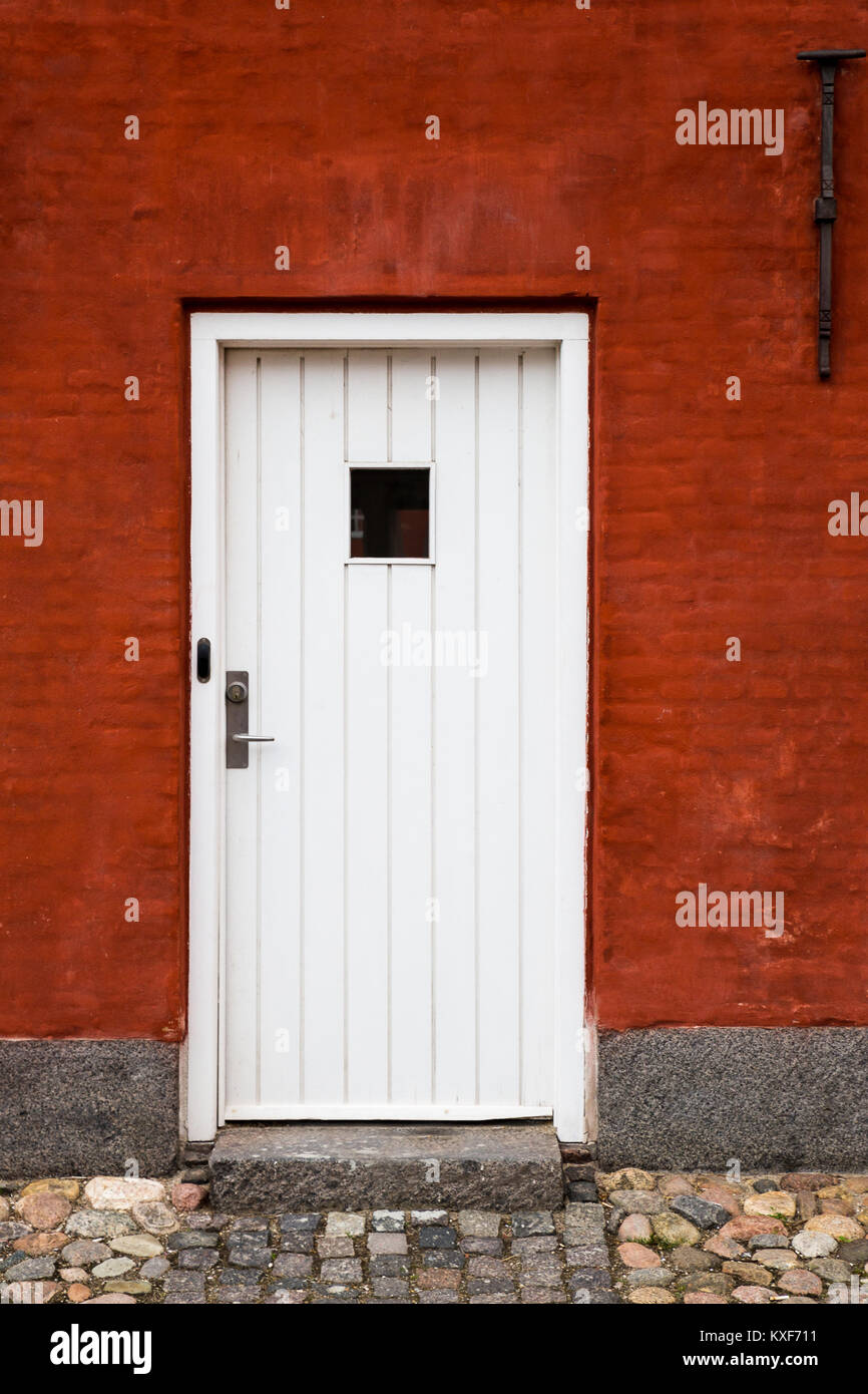 White Entry Door In Red Brick Building Close Up Exterior Europe