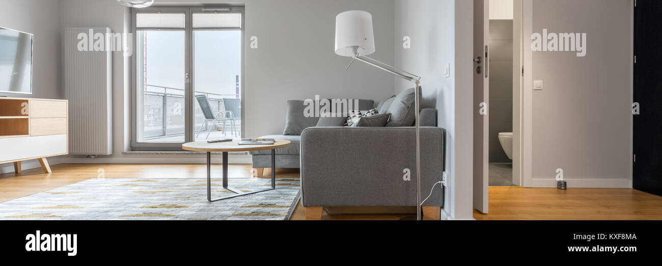 Panoramic view of modern apartment interior, living room, hallway and bathroom - Stock Image