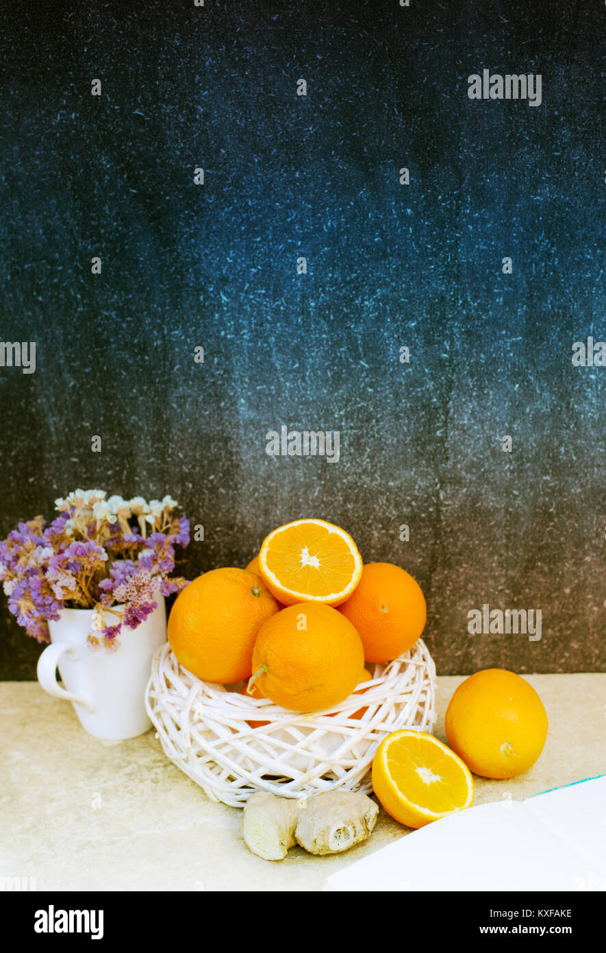 Kitchen with black chalk board wall and oranges cut in half Stock Photo