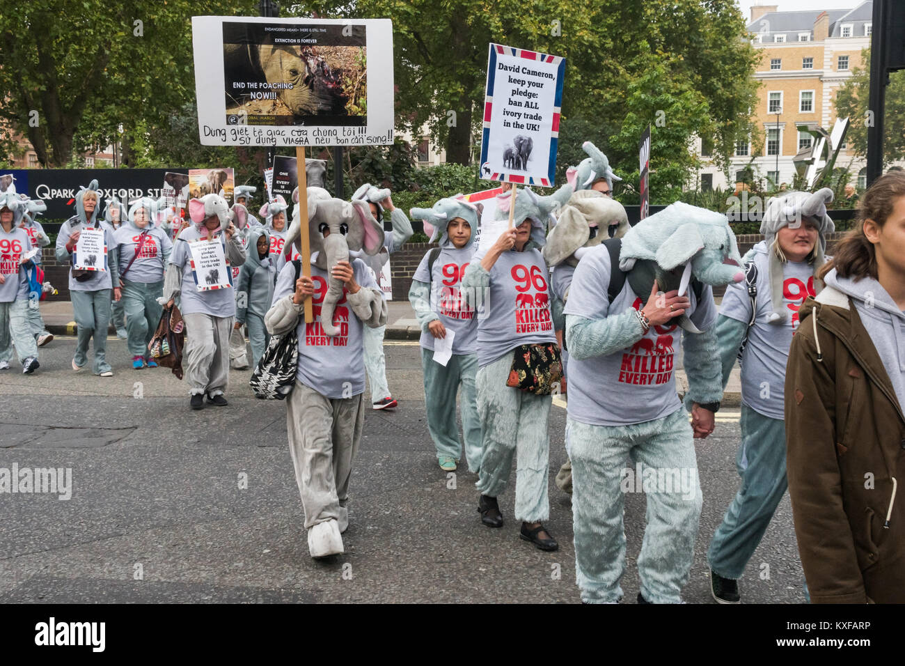 Some of the 96 marchers in elephant costumes at the front of the Global March for Elephants and Rhinos in London. - Stock Image