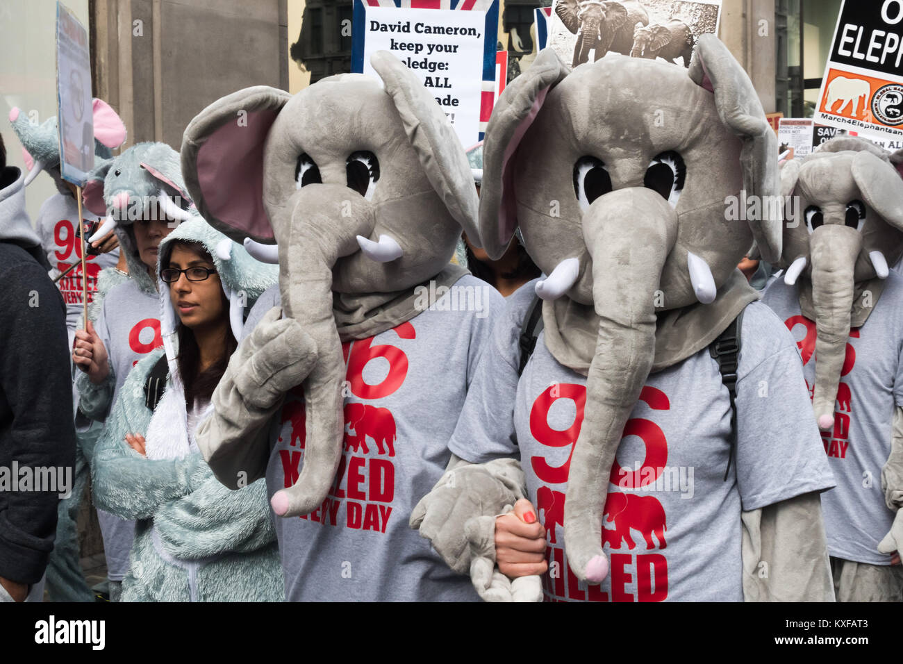 Some of the 96 people at the front of the Global March for Elephants and Rhinos in Londo wear elephant cosutems - Stock Image