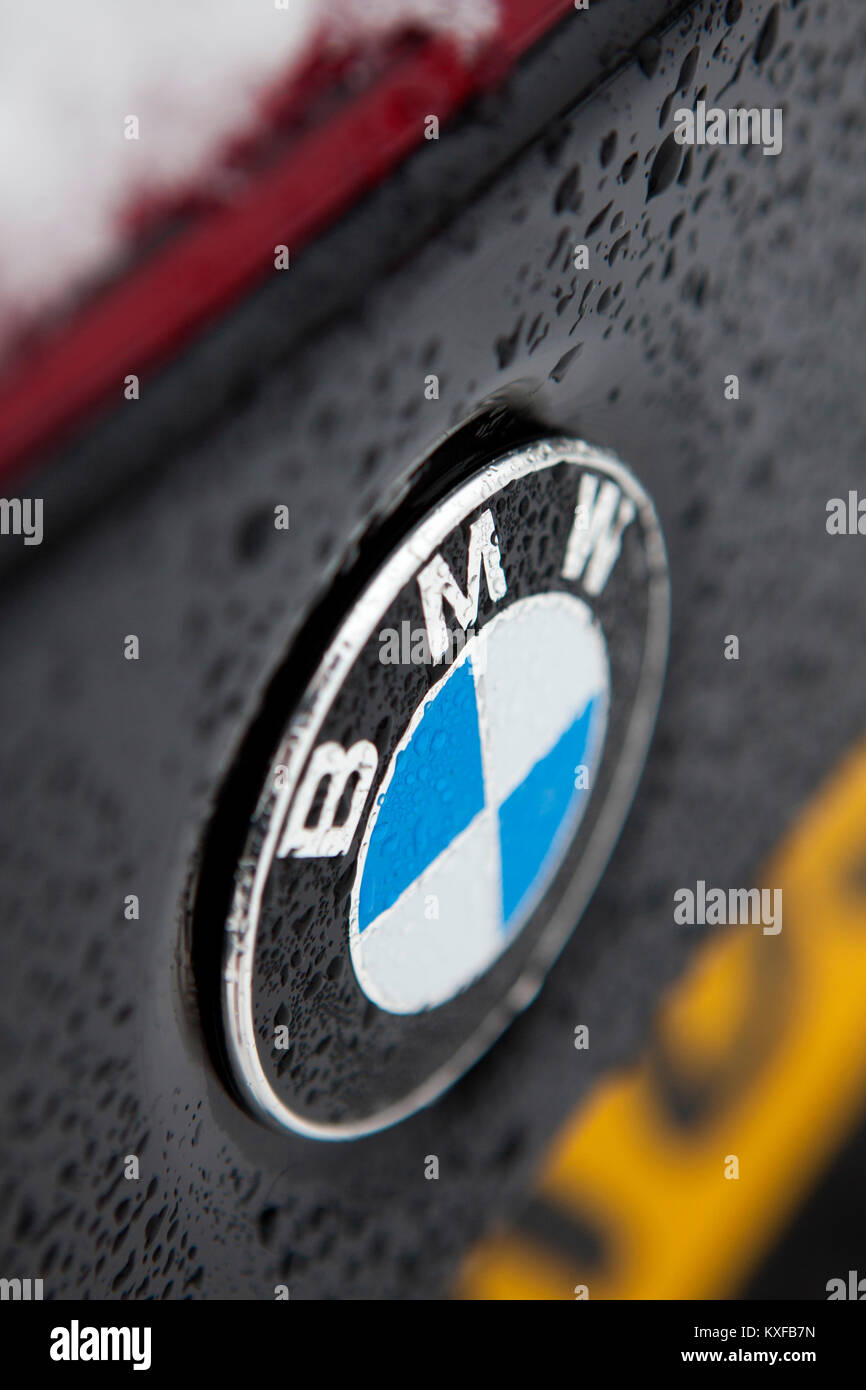 BMW Badge Close Up Detail Of A Black F83 2016 BMW M4 Convertible Car With  Water Droplets Forming From Rain
