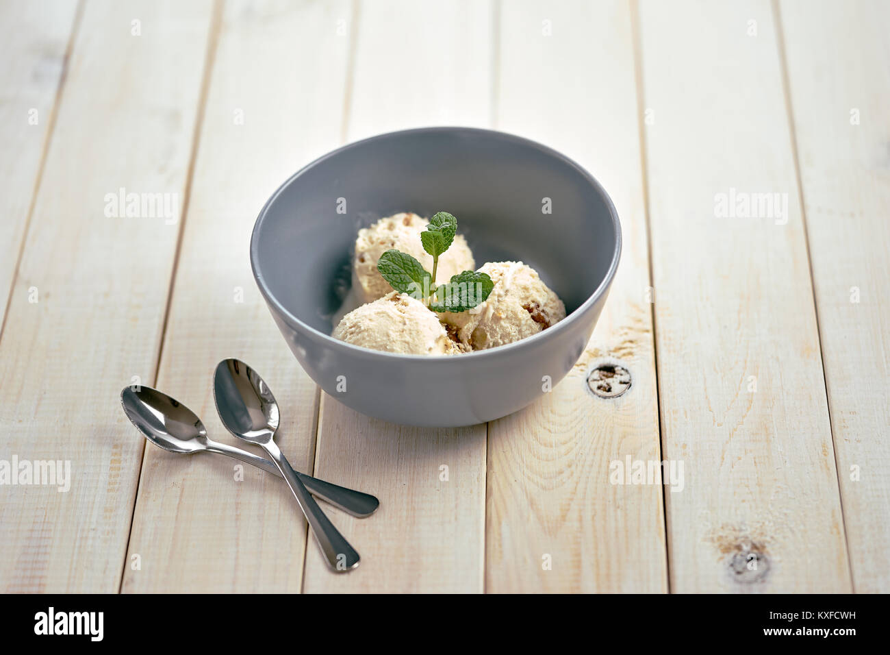 Vanilla ice cream in blue bowl Stock Photo