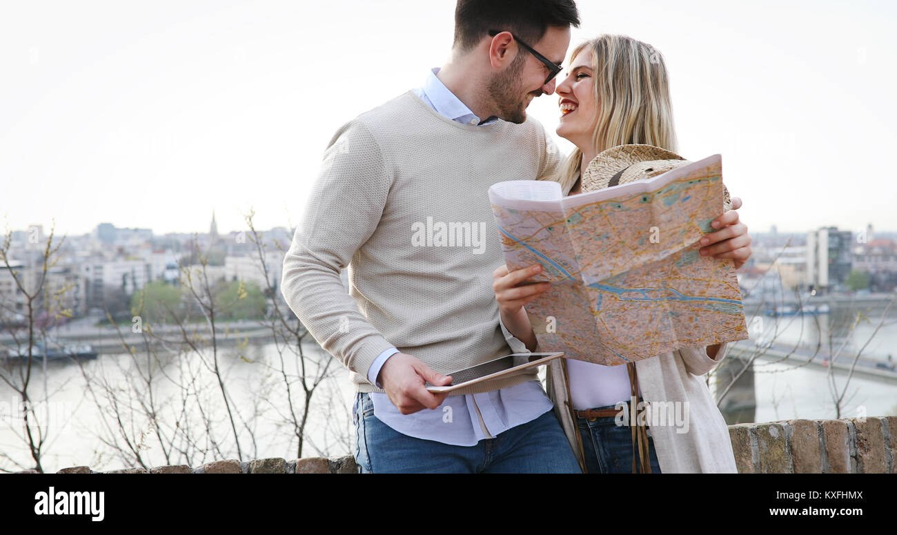 Tourist couple exploring city - Stock Image
