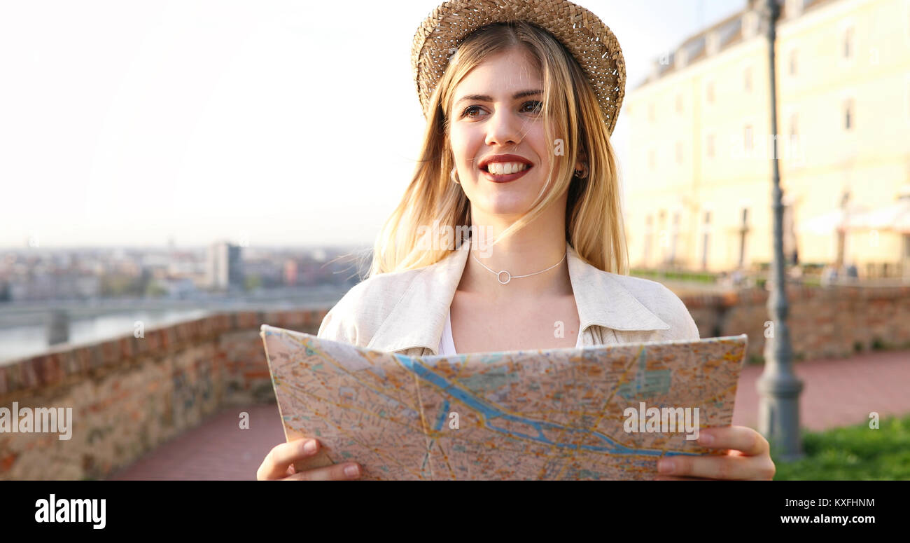Tourist woman looking at map - Stock Image