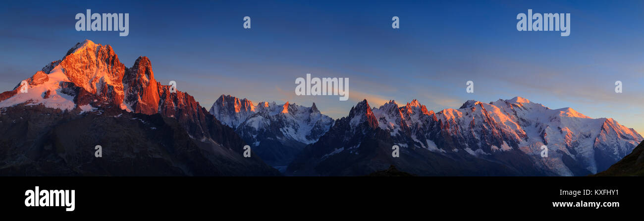 Panorama of the Alps near Chamonix, with Aiguille Verte, Les Drus, Auguille du Midi and Mont Blanc, during sunset. - Stock Image