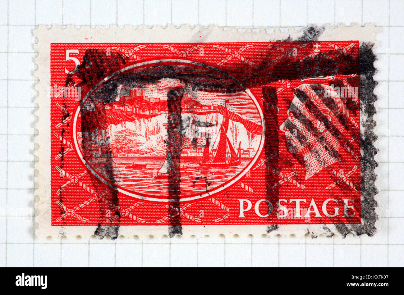 A King George VI used 5s red stamp of 1951 issue. - Stock Image