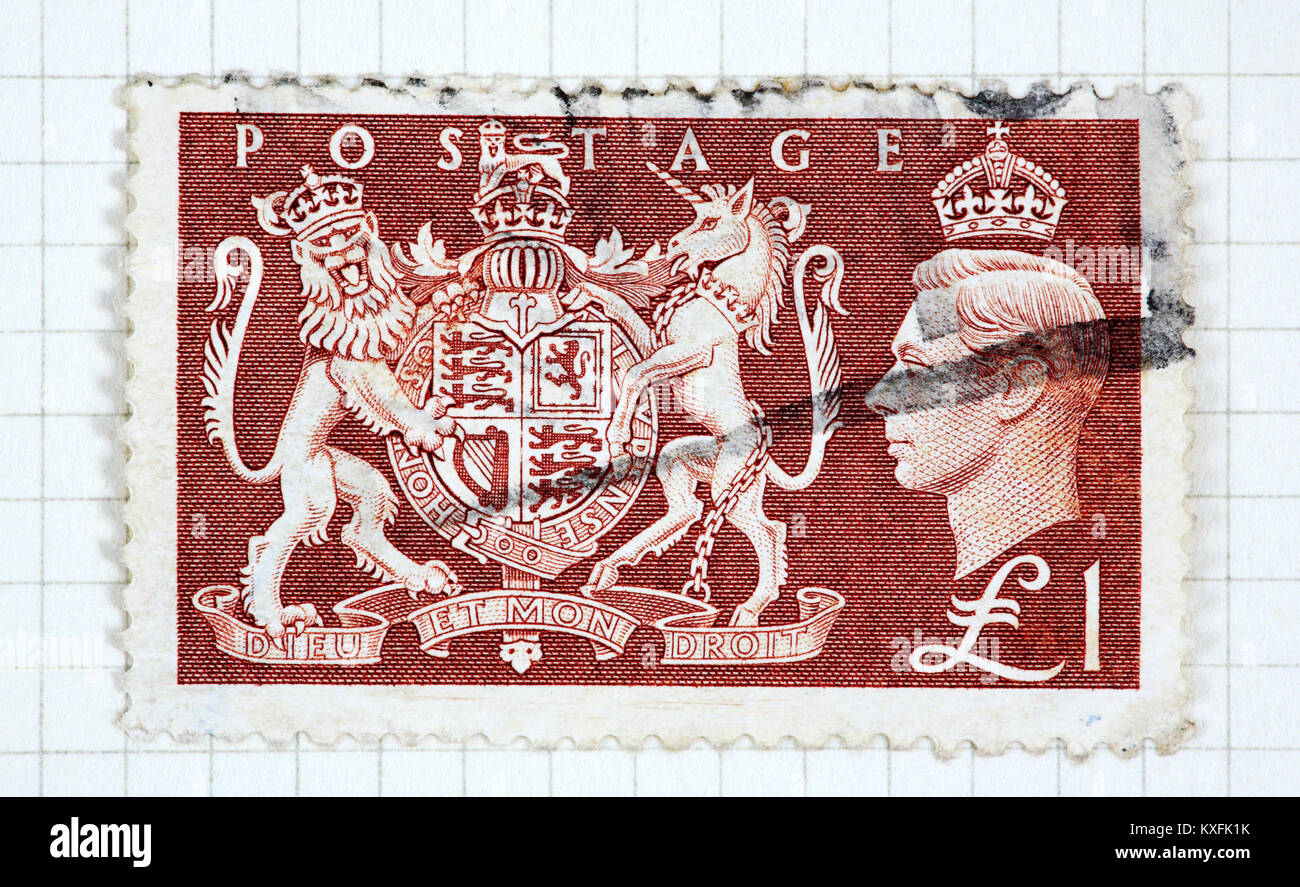 A used King George VI £1 brown stamp of 1951 issue. - Stock Image