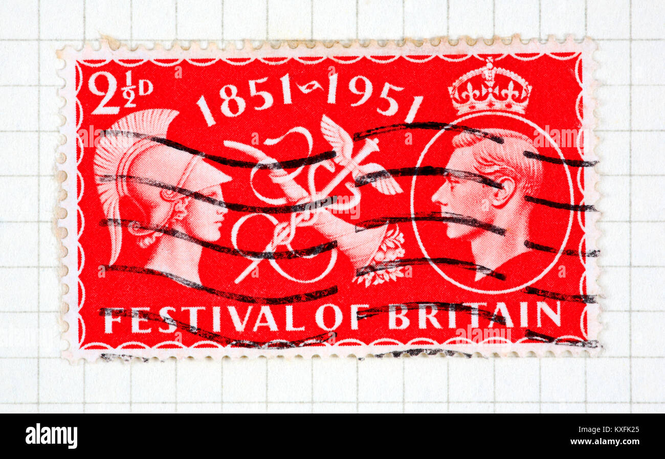A King George VI 21/2d red used Festival of Britain stamp of 1951 issue. - Stock Image