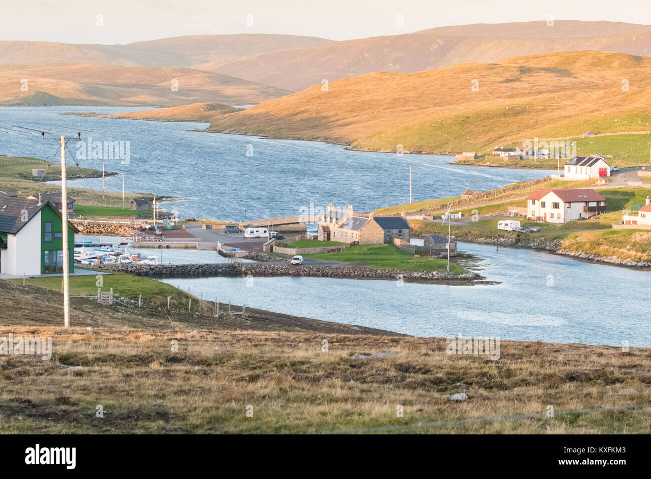 Bridge End Outdoor Centre and Marina at the head of South Voe with Lang Sound beyond seen from West Burra looking - Stock Image