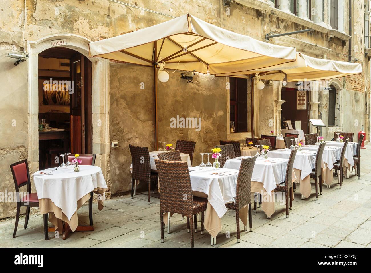 An outdoor restaurant in Veneto, Venice, Italy, Europe. - Stock Image