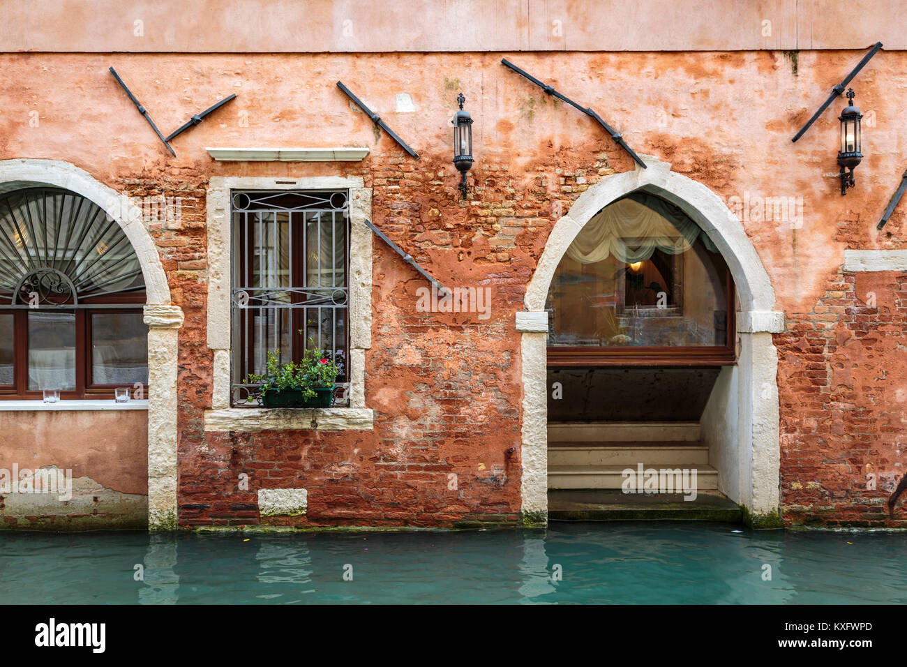 A building detail and canal in Veneto, Venice, Italy, Europe. - Stock Image
