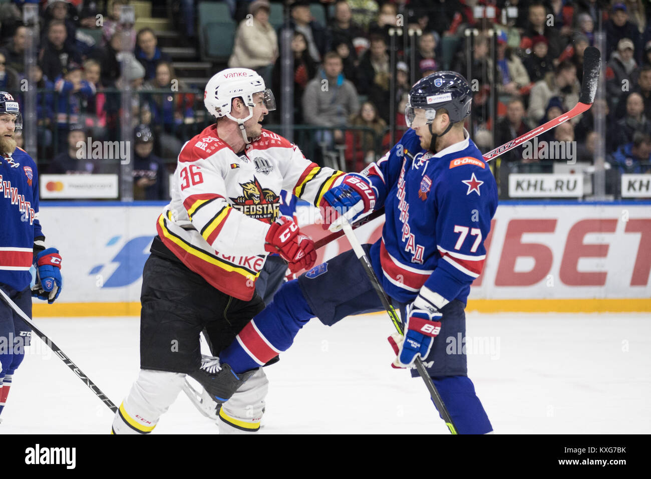 St. Petersburg. 10th Jan, 2018. Joonas Jarvinen (L) of Kunlun Red Star fights with Anton Belov of SKA during the Stock Photo