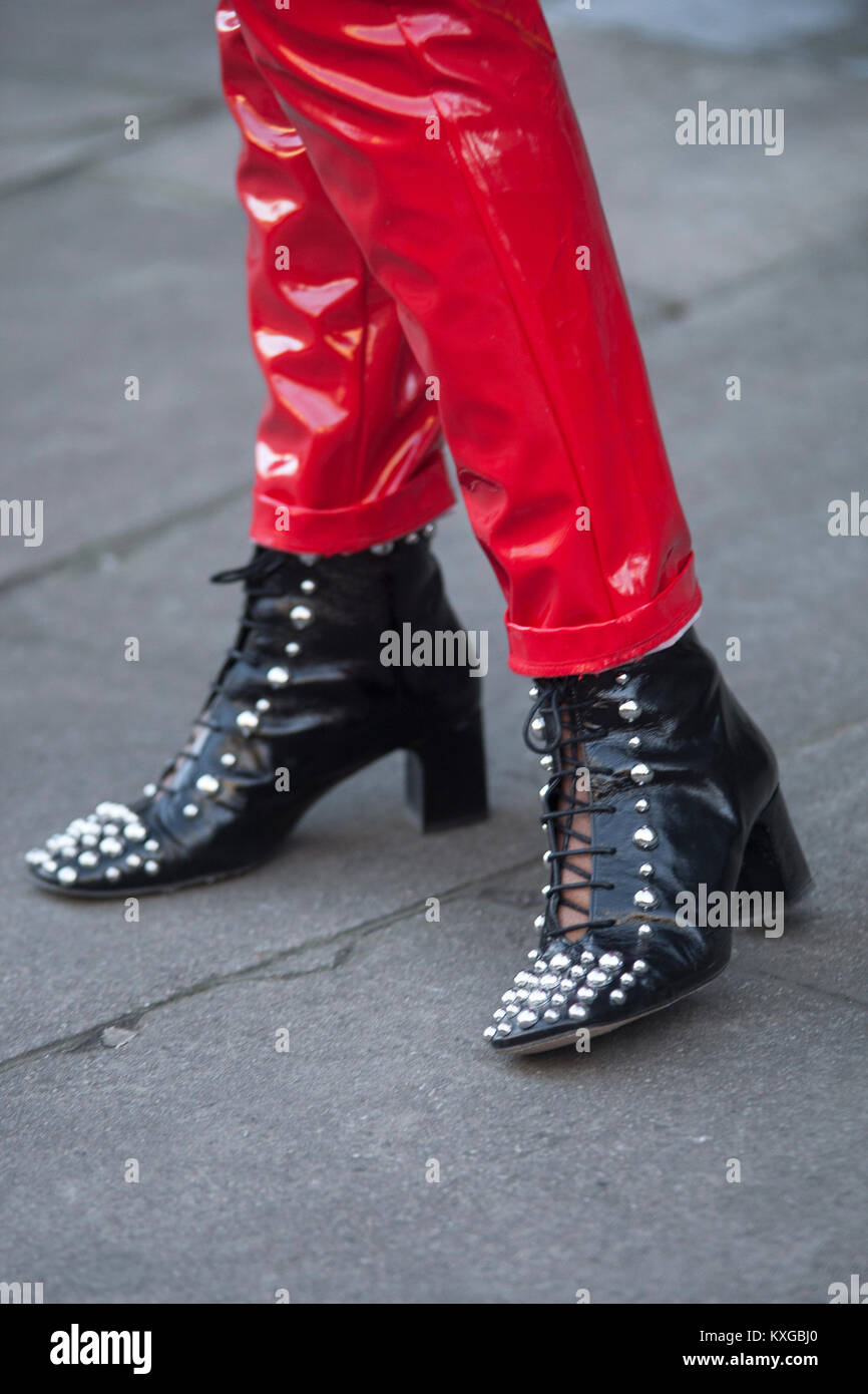 783511c8ad8 Street Style from day two of London Fashion Week Mens AW 2018. Image shows red  patent trousers with studded black leather ankle boots.