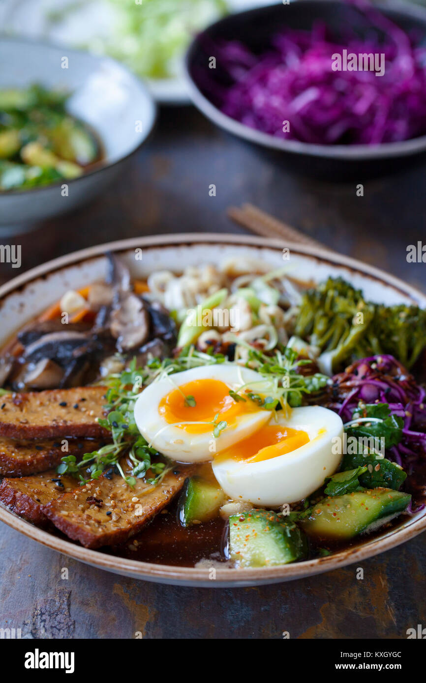 Vegetarian ramen with smoked tofu, pickled cabbage and cucumber - Stock Image