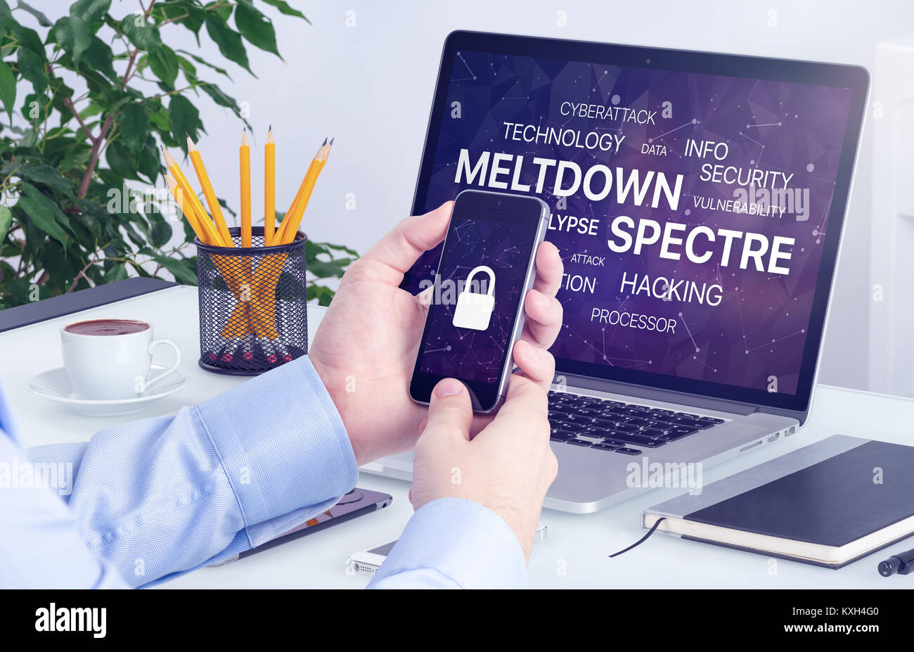 Meltdown and spectre threat concept on laptop and smartphone screen. - Stock Image