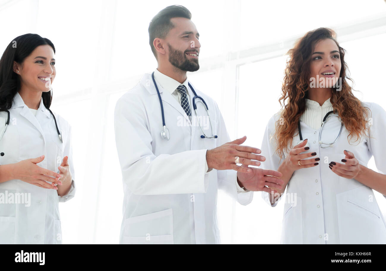closeup of a group of doctors discussing - Stock Image
