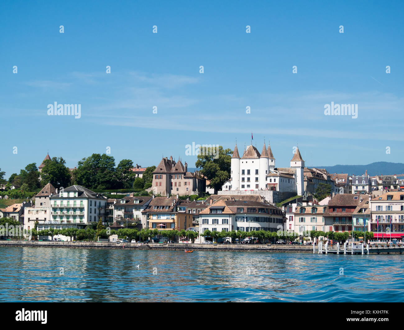Nyon by Lake Geneva with the castle atop the city - Stock Image