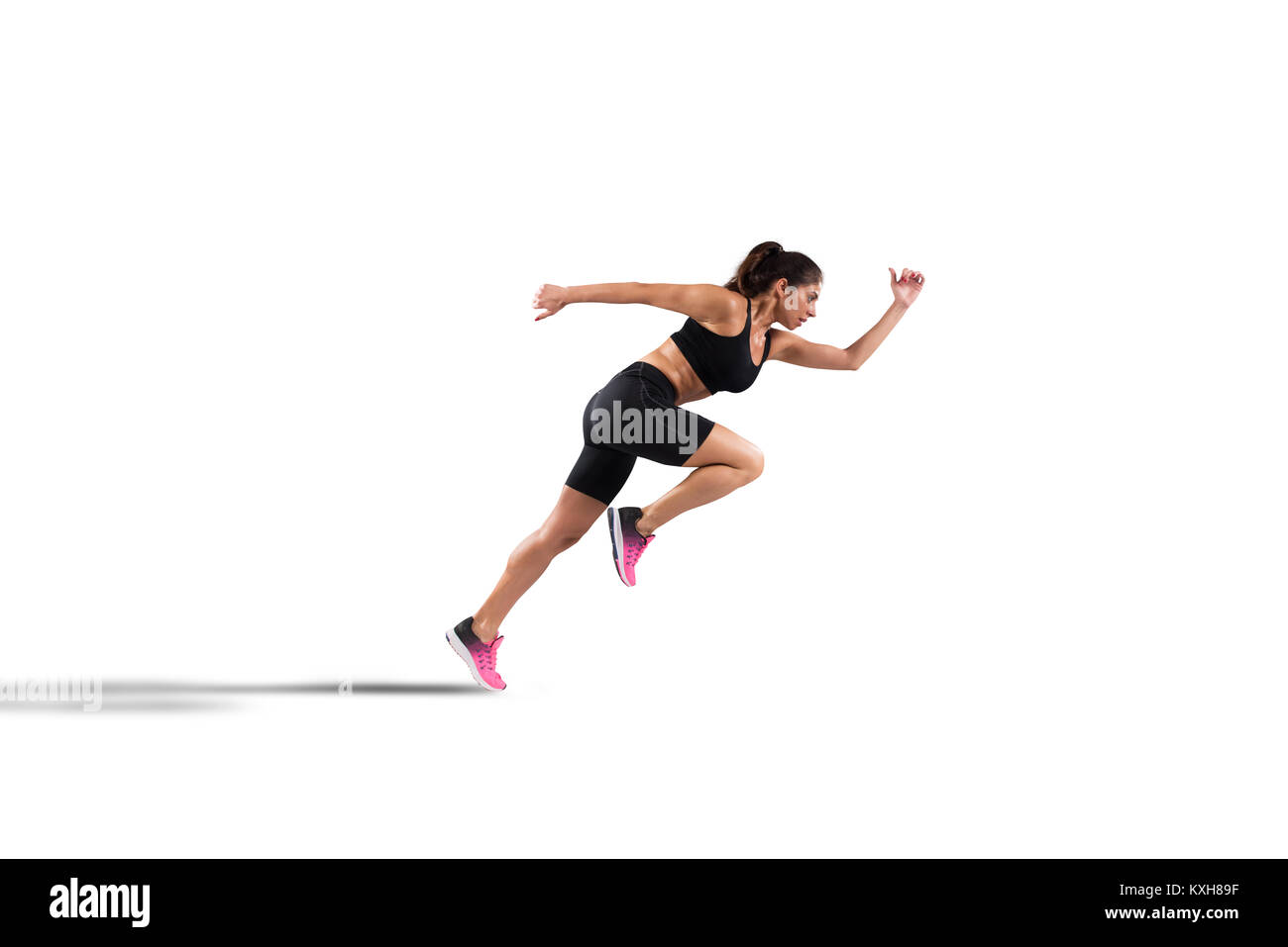 Athletic woman runner isolated on white background - Stock Image