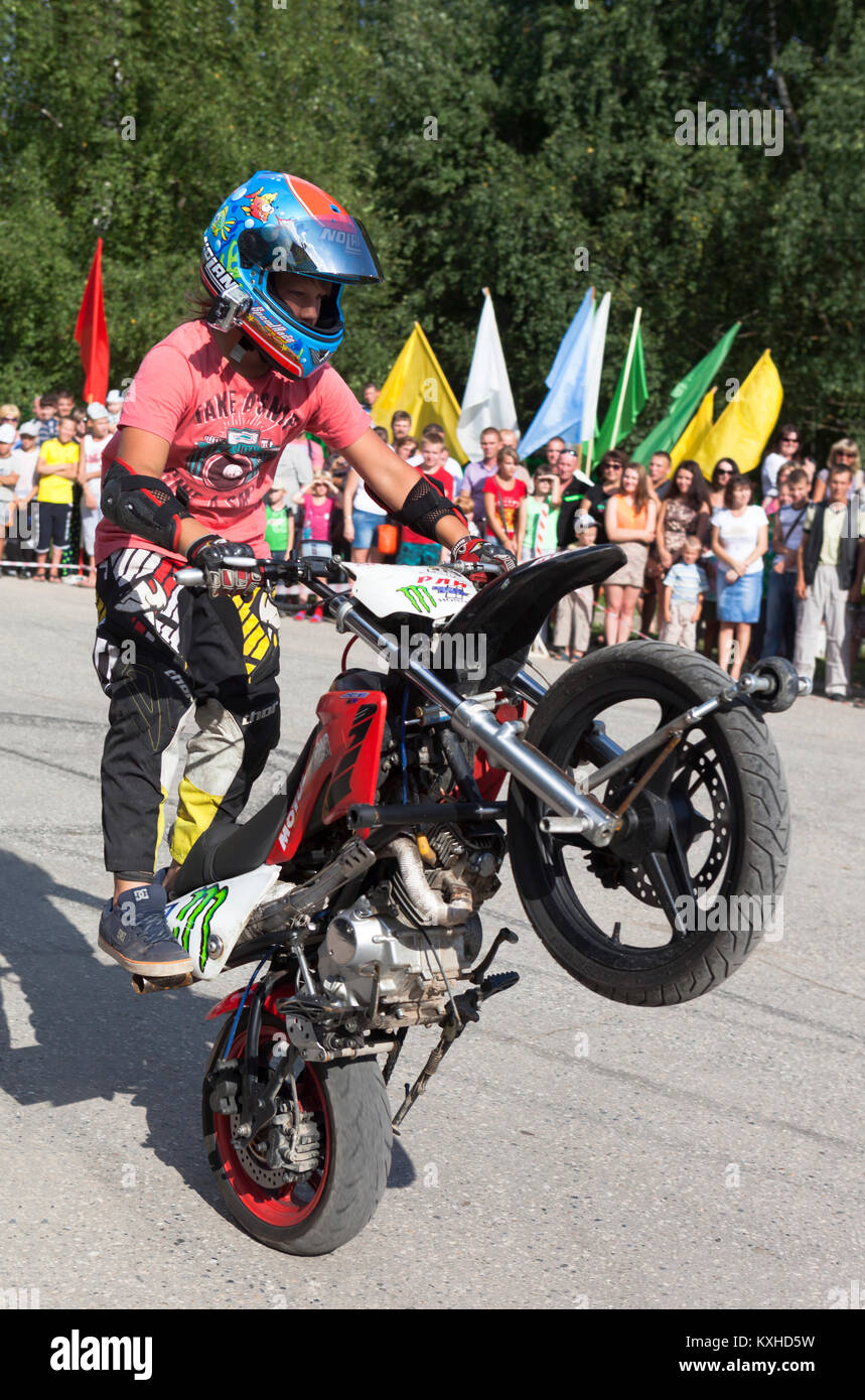 Verkhovazhye, Vologda region, Russia - August 10, 2013: Young stuntman Thomas Kalinin. Thomas Kalinin driving a - Stock Image