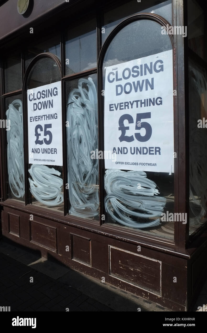 High street retail shop closure notices in closed shop window - Stock Image
