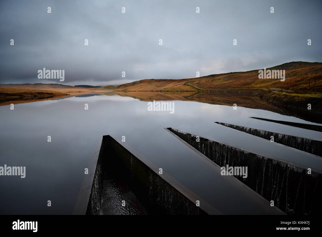 Craig y pistyll dam on a still overcast day - Stock Image