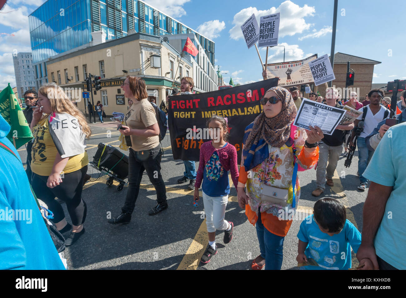 Near the front of the 'March Against Evictions' in Stratford is the 'Figth Racism! Fight Imperialism!' - Stock Image