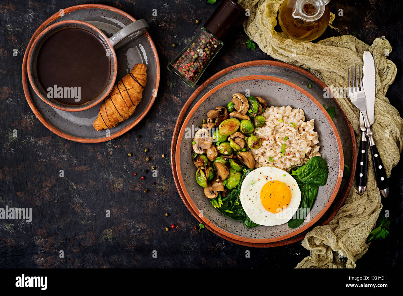 Healthy breakfast. Oat porridge, egg and salad of baked vegetables - mushrooms and Brussels sprouts. Healthy lifestyle. - Stock Image