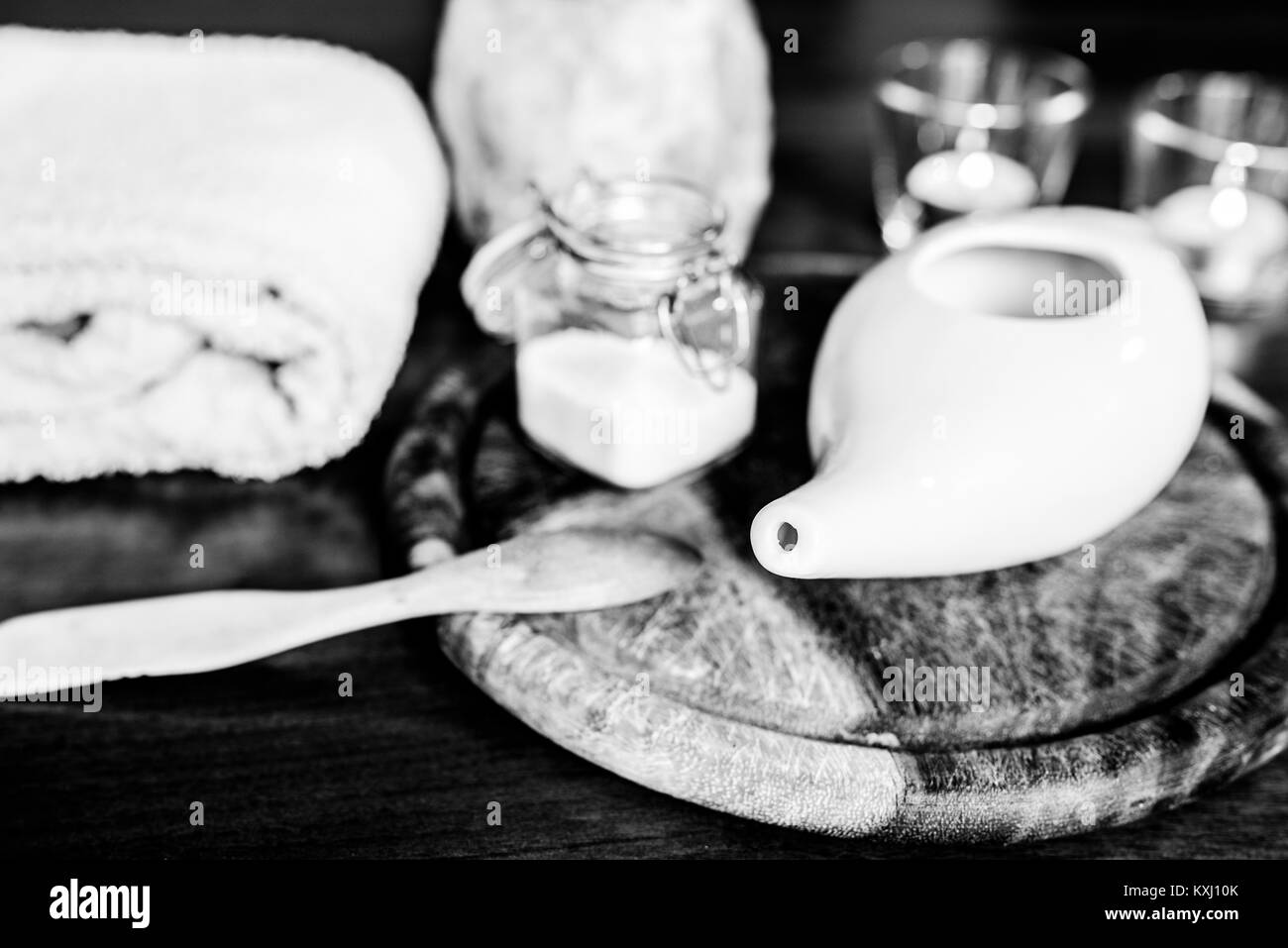neti pot, ayurvedic tools for cleaning nose with water and salt, view from top, wooden table and board on background - Stock Image