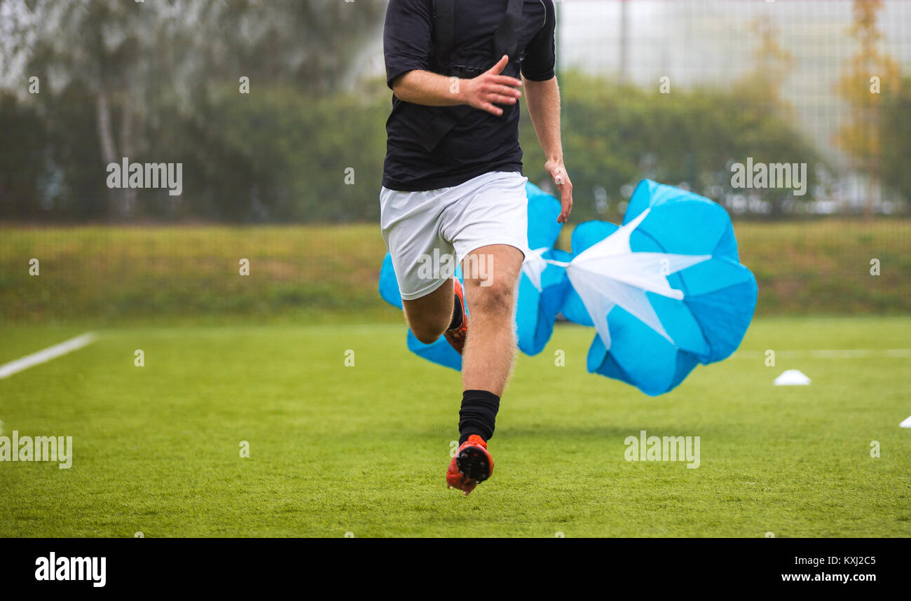 Soccer Football Endurance Training. Speed or Sprint Testing with Parachute. Professional Soccer Strength Test - Stock Image