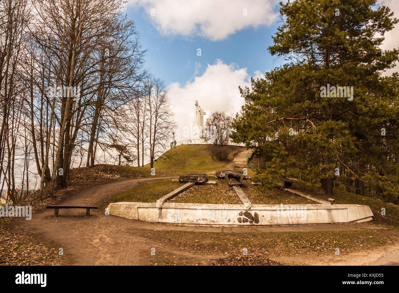 Remains of concrete Three crosses torn down in 1950 by soviets and a new monument of  Three crosses placed in 1989. Stock Photo