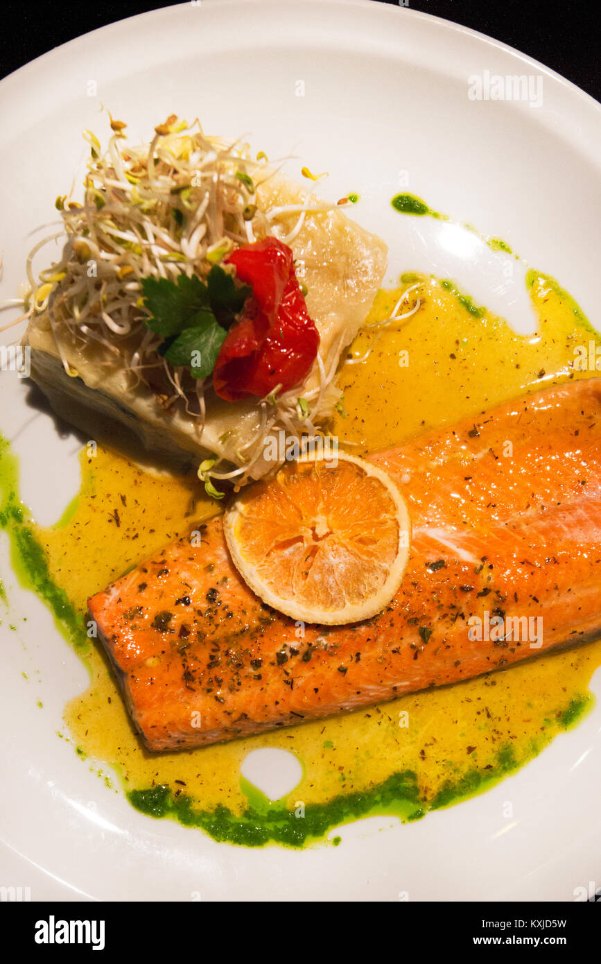 salmon in orange sauce, San Martin de los Andes, Argentina - Stock Image