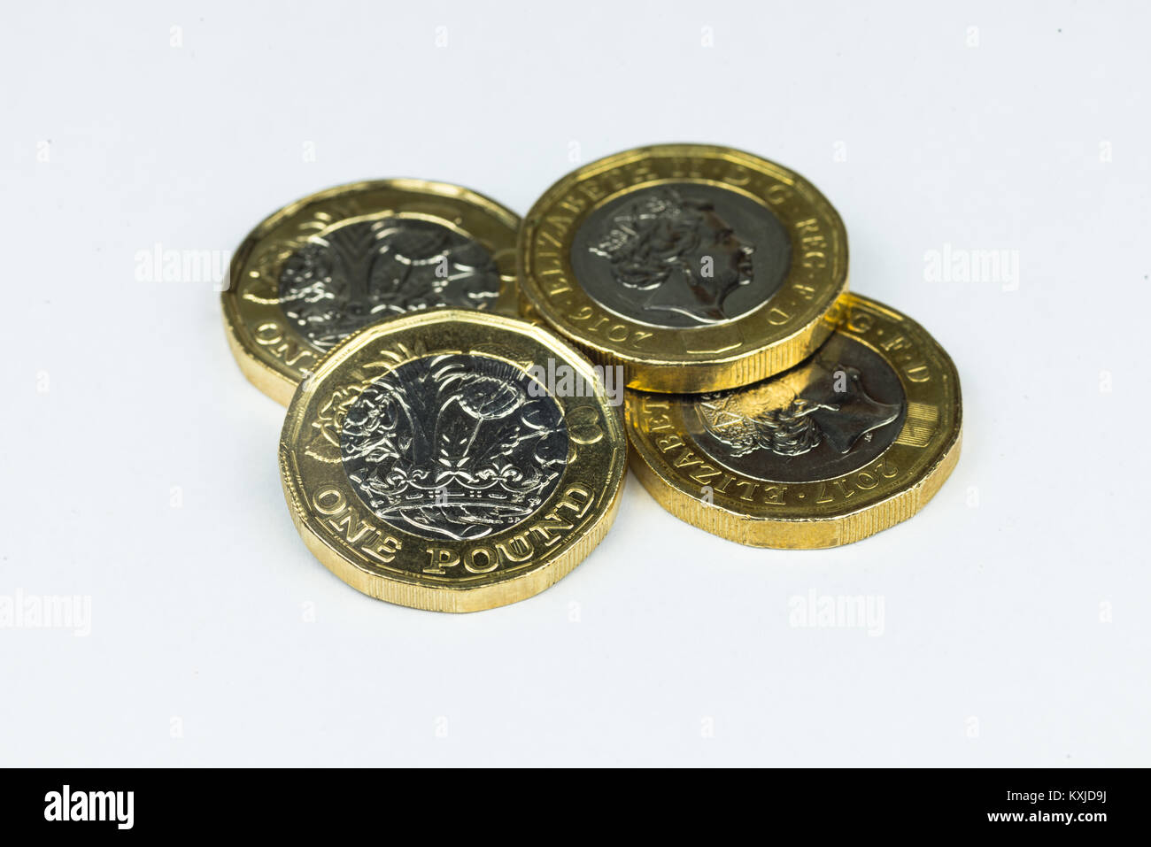 New one pound coins isolated in white background. Stock Photo